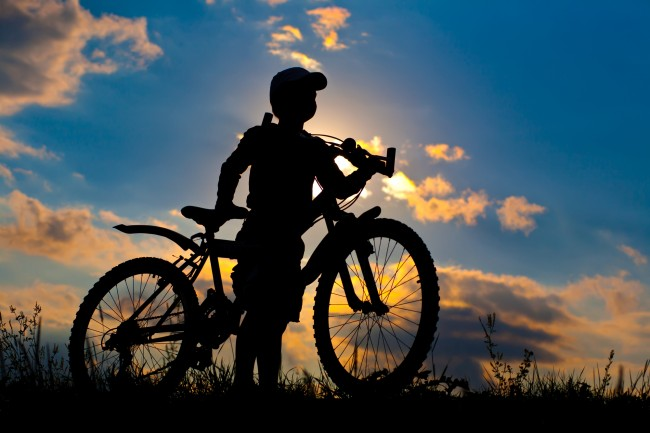 cyclist silhouette on a sunset sky